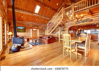 Large luxury log house living room with staircase.