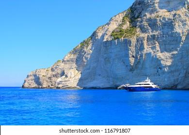 Large luxury motor yacht the near coast of the Greek island