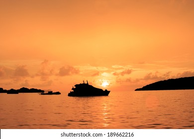 Large Luxury Yacht silhouette at sunset on ocean