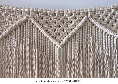 A large macrame wall hanging home decoration. Hand-made from 100% cotton rope.