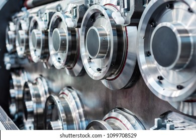 Large, massive steel rollers machines for wire drawing. Abstract industrial background.