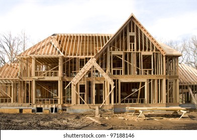 Large McMansion type house under construction in framing phase