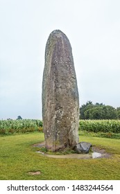Large Menhir isolated in a field. Dol de Bretagne. Brittany, France