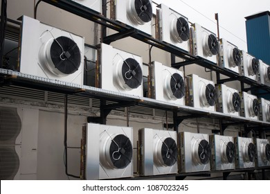 large metal air conditioners on the roof of the building