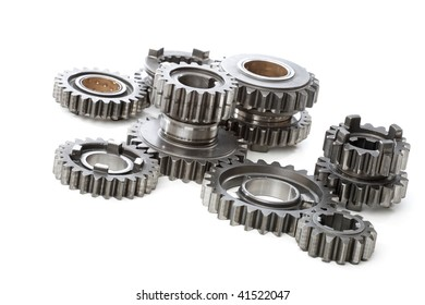 Large metal gears on white background.