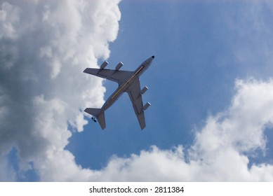 Large military tanker flying - shot from the ground