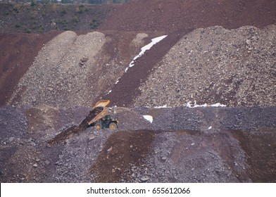 A large mine truck dumping its load