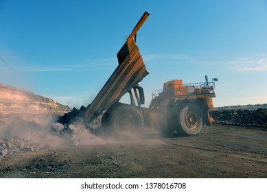 large mining loader unloads extracted ore or rock. View from the back. Mining concept