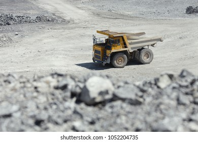 Large mining truck in a quarry. Mining industry. Quarry mining equipment.