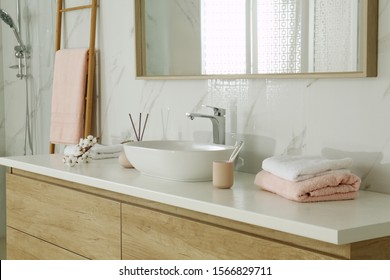 Large mirror over vessel sink in stylish bathroom interior