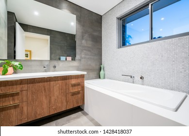 Large modern bathroom interior with luxury expensive finishings and large tiles. PERTH, WESTERN AUSTRALIA. Photographed: June, 2019.