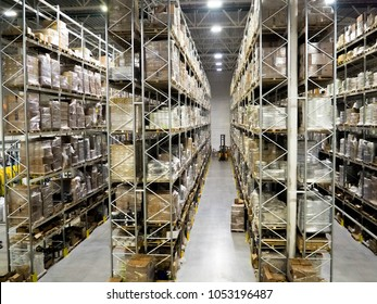 Large modern blurred warehouse industrial and logistics companies. Warehousing on the floor and called the high shelves