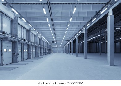Large modern empty storehouse with blue tint