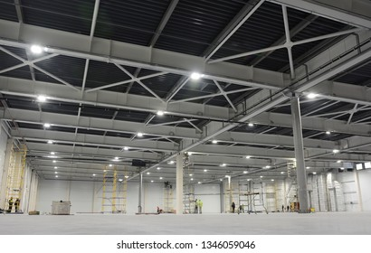 Large modern empty storehouse. Warehous building construction. Industrial warehouse interior.