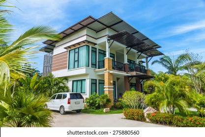 Large modern house with the car in the courtyard