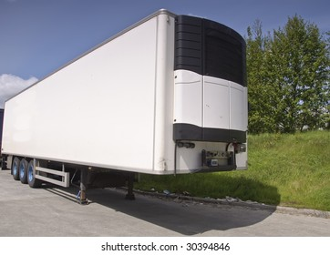 large modern refrigerated truck trailer freight, place advert on white. white refrigerator truck trailer container for transport of cold chilled food.