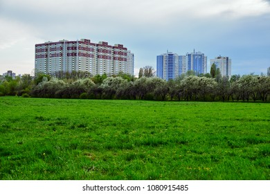 Large modern residential building and green field