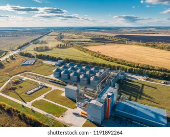 Large modern silos granary steel tanks or containers for silos, wheat and other cereals. Industrial agriculture and farming concept, aerial view