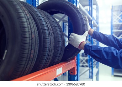 Large modern warehouse with forklifts and stack of car tires