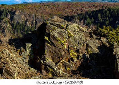 Large moss rock boulders on the edge of Black Canyon of the Gunnison National Park in Colorado