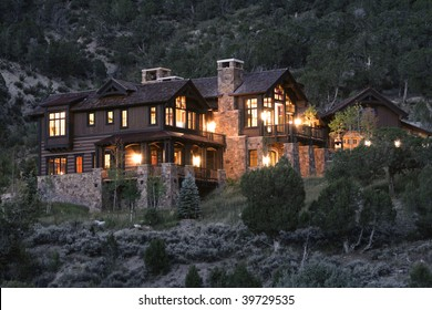 Large mountain mansion at dusk
