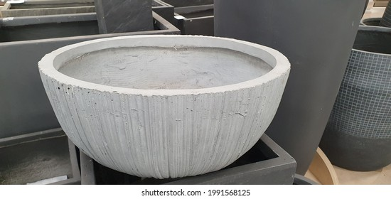 Large new pot for flowers and plants. A beautiful pot with a beautiful ornament and texture. Large pot on a shelf in a store.