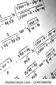 Large number of mathematical formulas on a white background