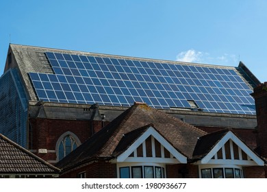 Large number of solar panels on huge roof on clear day