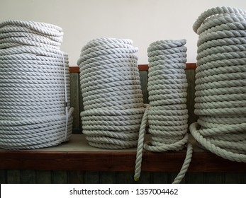 A large number of the twisted ropes in a roll. Ropes on a counter of shop. Sale of various ropes. Wide range of use