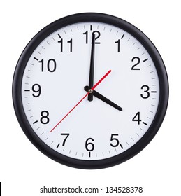 Large office clock shows exactly four o'clock