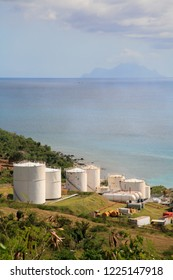 Large oil storage tanks on the coast of the island of Sint Maarten in the Caribbean