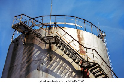 Large oil tank in industrial plant at twilight