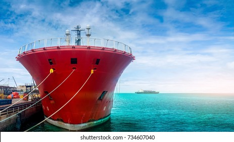 large oil tanker, oil tanker ship in shipyard waiting for repair on sea water and blue sky background