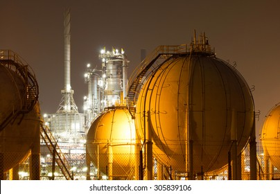 A large oil-refinery plant with Liquefied Natural Gas (LNG) storage tanks