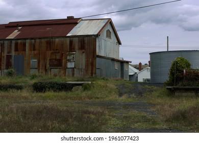 Large old corrugated iron shed by the Korumburra Railway Station, South Gippsland, Victoria, Australia.