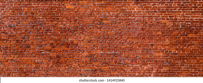 Large Old Red Brick Wall Background. Wide Angle Vintage Brick Texture. Panoramic Web banner or Wallpaper With Copy Space for design.