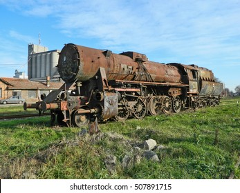 Large, old steam locomotive, which for years waiting for repair and Museum.