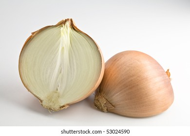 Large onion sliced in half isolated