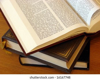 The large opened book with the incorporated page lays on a table