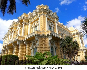 Large opulent colonial house / villa with stunning decoration and tropical plants in foreground on Paseo de Montejo boulevard in Merida, beautiful colonial city in Yucatan, Mexico