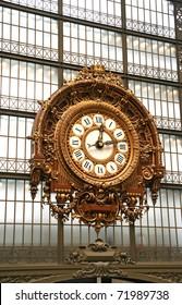Large ornate railway clock in Paris