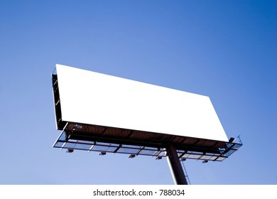large outdoor blank billboard on a rich blue sky