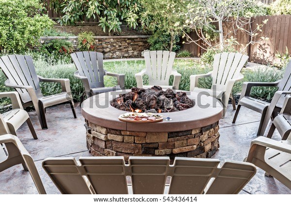 Amazing Large Outdoor Fire Pit Surrounded By Parks Outdoor Food Bralicious Painted Fabric Chair Ideas Braliciousco