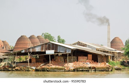 Large ovens, kilns, used to cure clay bricks in the Mekong Delta, Vietnam.