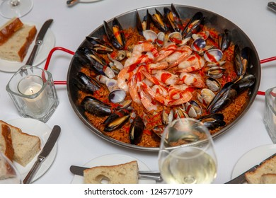 Large Pan of Fresh Seafood Paella with Shrimp, Clams, and Mussels