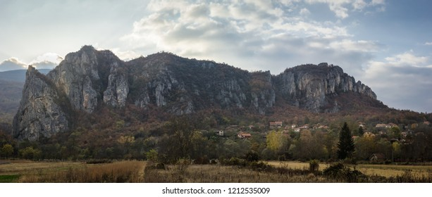 Large panorama of iconic village Vlasi at the base of a rocky mountain and at the entrance of famous Jerma River canyon - Shutterstock ID 1212535009