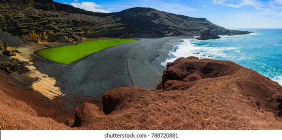 Large panorama of Volcanic green lake (El Lago Verde, Charco de los Clicos) in El Golfo. Lanzarote. Canary Islands. Spain