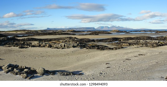 Large panoramic view of the Isles of Eigg and Rum from Invercaimbe at Arisaig on the road to the isles.
