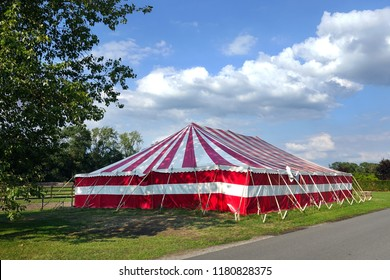 Large party Marquee, red and white stripped event tent set in the countryside.