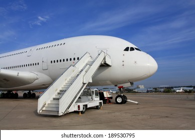 Large passenger jet  with attached ladder